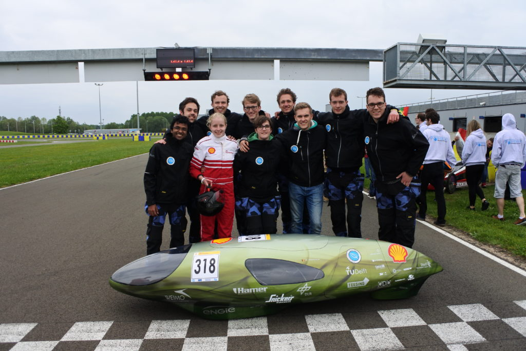 Eco-Runner and team on racetrack